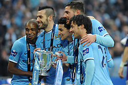 Manchester City players hold the Capital One Cup - Photo mandatory by-line: Dougie Allward/JMP - Tel: Mobile: 07966 386802 02/03/2014 - SPORT - FOOTBALL - London - Wembley Stadium - Manchester City v Sunderland - Capital One Cup Final