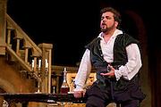 """""""Rigoletto"""" opera at the Dicapo Opera Theatre, conducted by Pacien Mazzagatti; directed by Anthony Laciura. Cast: Zurab Ninua as Rigoletto; Anna Noggle as Gilda; Rafael Davila as Duke of Mantua."""