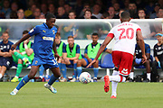 AFC Wimbledon attacker Michael Folivi (17) taking on Rotherham United defender Michael Ihiekwe (20) during the EFL Sky Bet League 1 match between AFC Wimbledon and Rotherham United at the Cherry Red Records Stadium, Kingston, England on 3 August 2019.