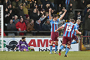 Tom Hopper of Scunthorpe United  hands in the air celebrates Paddy Madden of Scunthorpe United scoring to go 3-0 up during the Sky Bet League 1 match between Scunthorpe United and Colchester United at Glanford Park, Scunthorpe, England on 23 January 2016. Photo by Ian Lyall.