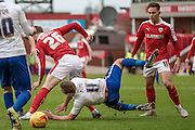 \Tom Pope (Bury) is fouled by Alfie Mawson (Barnsley) during the Sky Bet League 1 match between Barnsley and Bury at Oakwell, Barnsley, England on 7 February 2016. Photo by Mark Doherty.