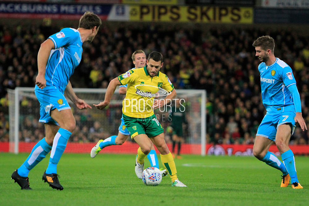 Norwich City midfielder Wes Hoolahan (14) makes a run between Burton Albion defender Ben Turner (6) and Burton Albion midfielder Luke Murphy (7) during the EFL Sky Bet Championship match between Norwich City and Burton Albion at Carrow Road, Norwich, England on 12 September 2017. Photo by Richard Holmes.