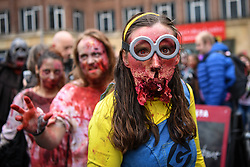 © Licensed to London News Pictures. 05/10/2019. London, UK.  Participants take part the annual zombie walk through central London on World Zombie Day in support of the prevention of hunger and homelessness (the charity for 2019 is City Harvest London). This year is billed as being the last gathering that London will host after running for 9 years, as the organisers disband the event. Photo credit: Guilhem Baker/LNP