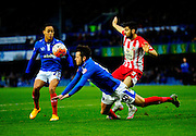 Portsmouth's Marc McNulty goes down in the penalty area under the challenge of Accrington Stanley's Matty Pearson during the The FA Cup match between Portsmouth and Accrington Stanley at Fratton Park, Portsmouth, England on 5 December 2015. Photo by Graham Hunt.