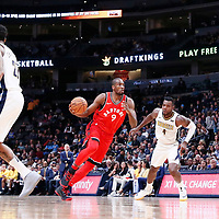 01 November 2017: Toronto Raptors forward Serge Ibaka (9) drives past Denver Nuggets forward Paul Millsap (4) during the Denver Nuggets 129-111 victory over the Toronto Raptors, at the Pepsi Center, Denver, Colorado, USA.