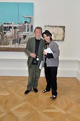 SIR JOHN HURT and ANWEN REES MEYERS at the annual Royal Academy of Art Summer Party held at Burlington House, Piccadilly, London on 4th June 2014.