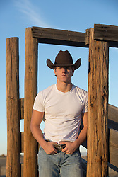 Good looking All American sexy cowboy on a ranch