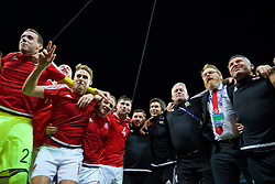 LILLE, FRANCE - Friday, July 1, 2016: Wales players celebrate in the team huddle following a 3-1 victory over Belgium and reaching the Semi-Final during the UEFA Euro 2016 Championship Quarter-Final match at the Stade Pierre Mauroy. goalkeeper Daniel Ward, David Edwards, David Vaughan, Ben Davies, equipment manager David Griffiths, Doctor Rhodri Martin, Mike Murphy, head of international affairs Mark Evans, assistant manager Osian Roberts. (Pic by David Rawcliffe/Propaganda)
