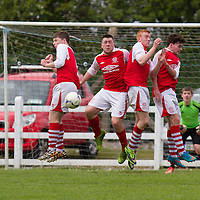 Newmarket Celtic's wall saves a  free kick during the Youths Cup FInal