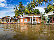 19 JUNE 2016 - DON KHONE, CHAMPASAK, LAOS:  Floating bungalows in the Mekong River for tourists visiting Don Khone village on Don Khone Island. Don Khone Island, one of the larger islands in the 4,000 Islands chain on the Mekong River in southern Laos. The island has become a backpacker hot spot, there are lots of guest houses and small restaurants on the north end of the island.     PHOTO BY JACK KURTZ