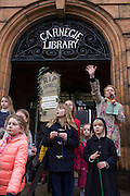 Faced with the closure of its beloved local library, the people of Herne Hill, Lambeth, south London hold a demonstration outside the Edwardian library. Lambeth council plan to close the facility used by the community as part of austerity cuts, saying they will convert the building into a gym and privatey-owned gentrified businesses - rather than a much-loved reading and learning resource. £12,600 was donated by the American philanthropist Andrew Carnegie to help build the library which opened in 1906. It is a fine example of Edwardian civic architecture, built with red Flettan bricks and terracotta, listed as Grade II in 1981.