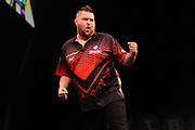 Michael Smith, 2013 World Youth Champion. Second Premier League season beats Peter Wright, 2017 UK Open champion & Premier League finalist during the Unibet Premier League Darts Night 13 competition at the Manchester Arena, Manchester, United Kingdom on 26 April 2018. Picture by Mark Pollitt.