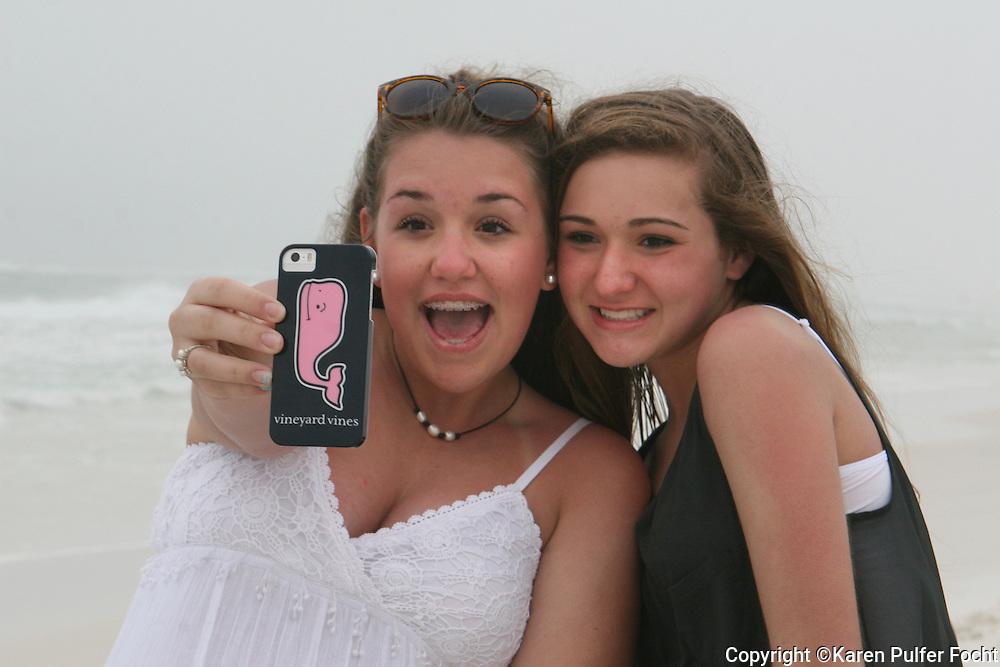 Portraits of female teens making selfie on the Beach. Model Release