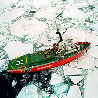Antarctica, Prince Gustav Channel. Greenpeace ice breaker ARCTIC SUNRISE during circumnavigation of James Ross island, Antarctica made possible by melting ice due to temperature rise
