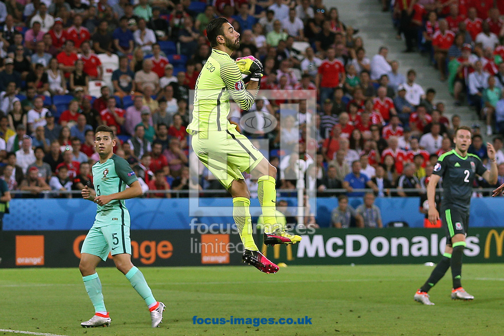 Rui Patricio of Portugal collects the ball safely during the UEFA Euro 2016 semi-final match at Stade de Lyons, Lyons<br /> Picture by Paul Chesterton/Focus Images Ltd +44 7904 640267<br /> 06/07/2016