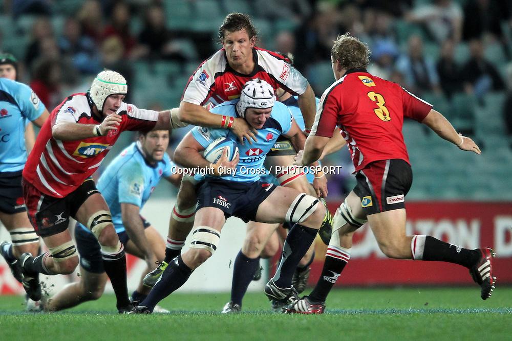 Ben Mowen is taken by Michael Rhodes. NSW Waratahs v Lions. Investec Super Rugby Round 14 Match, 21 May 2011. Sydney Football Stadium, Australia. Photo: Clay Cross / photosport.co.nz