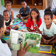 Dulce Lopes reads an animal picture book to the children and asks them to make the sounds of each creature and through this game the children learn about the animals of the world. The Alola Foundation provide pre-school play and learn sessions. Education in Timor-Leste is very basic with classes up to 80 children and teachers trained under an old fashined system with very little inter-action between teacher and pupils..Fundasaun Alola is a not for profit non government organization operating in Timor Leste to improve the lives of women and children. Founded in 2001 by the then First Lady, Ms Kirsty Sword Gusmao, the organization seeks to nurture women leaders and advocate for the rights of women.