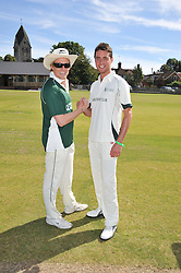 Left to right, team captains ANTHONY BECHER and HARRY LANGTON at a cricket match to in aid of CARE - Corfu Animal Rescue Establishment held at Hawkley Cricket Club, Hawkley, Hampshire on 8th September 2012.