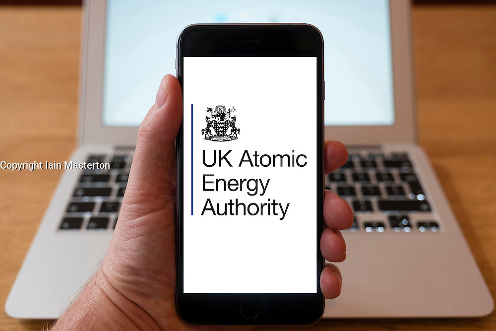 Using iPhone smartphone to display logo of the UK Atomic Energy Authority