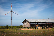 Elevated barn beside a wind turbine on a windfarm in Ninh Thuan Province, Vietnam<br /> , Southeast Asia