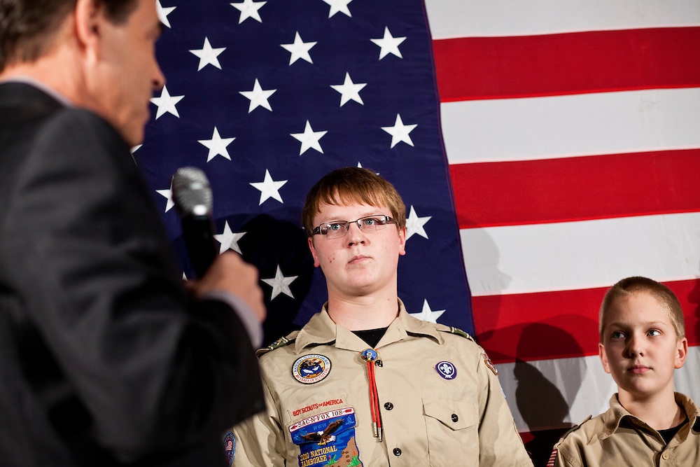 Boy scouts listen as Republican presidential candidate Rick Perry speaks at a Cerro Gordo County GOP Fundraiser on Friday, December 30, 2011 in Mason City, IA