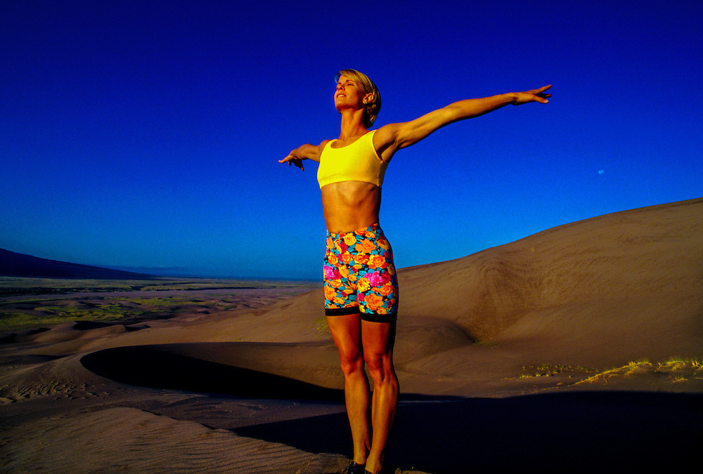 Woman exercising, Great Sand Dunes National Park, near Alamosa, Colorado