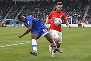 Gillingham defender Deji Oshilaja and Coventry City forward Adam Armstrong  during the Sky Bet League 1 match between Gillingham and Coventry City at the MEMS Priestfield Stadium, Gillingham, England on 2 April 2016. Photo by Martin Cole.