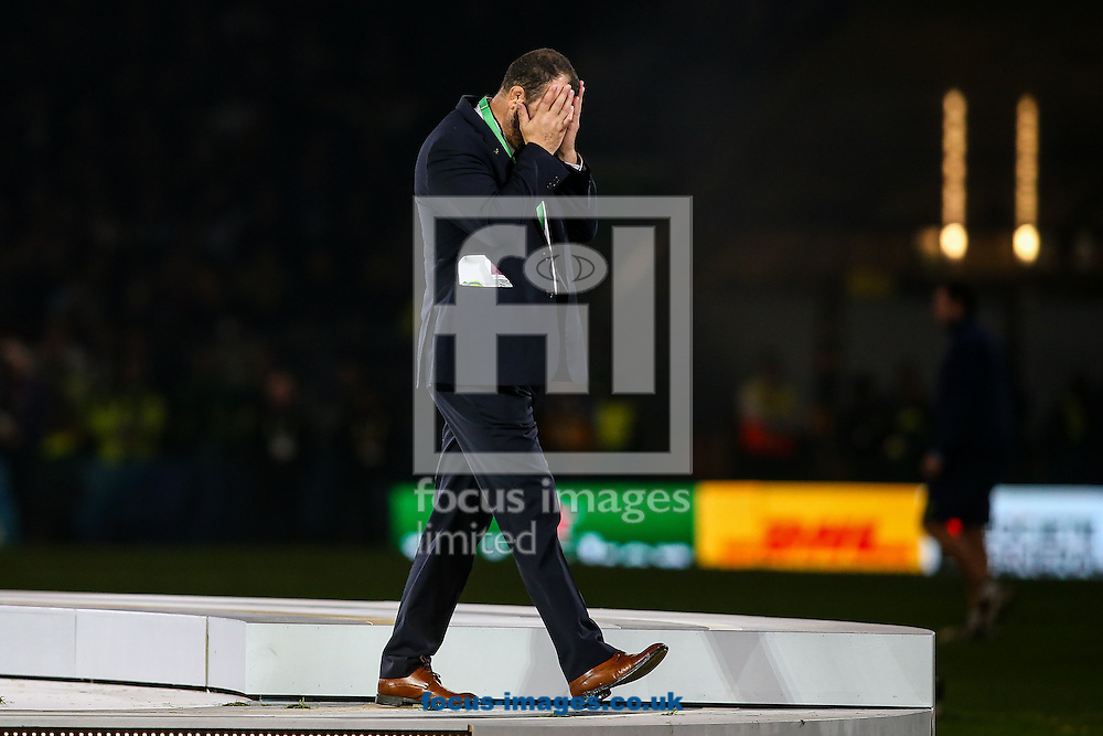 Australia head coach Michael Cheika holds his head in his hands as he leaves the stage after the final of the 2015 Rugby World Cup at Twickenham Stadium, Twickenham<br /> Picture by Andy Kearns/Focus Images Ltd 0781 864 4264<br /> 31/10/2015