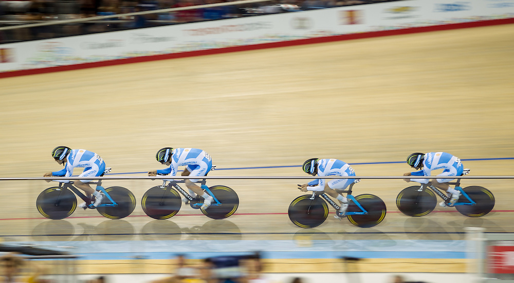 The Argentinian men's team races to a silver medal in the cycling team pursuit at the 2015 Pan American Games in Toronto, Canada, July 19,  2015.  AFP PHOTO/GEOFF ROBINS