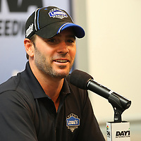 Driver Jimmie Johnson is seen in the media interview area prior to the NASCAR Coke Zero 400 Sprint practice session at the Daytona International Speedway on Thursday, July 4, 2013 in Daytona Beach, Florida.  (AP Photo/Alex Menendez)