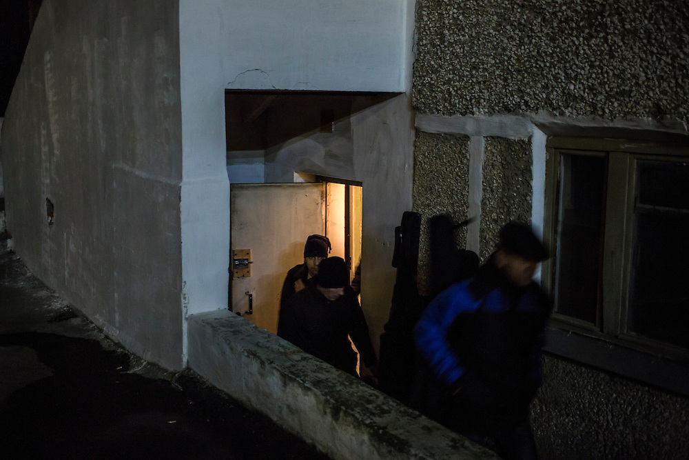 Members of the band Hammer and Sickle leave their practice space in the basement of a local school on Tuesday, November 12, 2013 in Asbest, Russia.