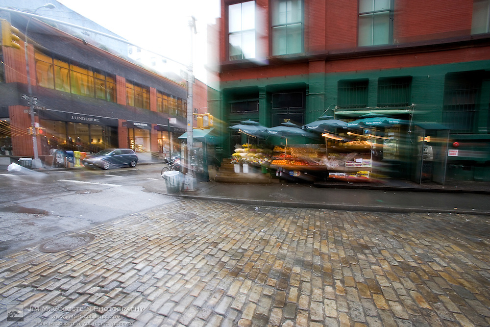 Rainy view of a New York city fruit stand in the SoHo district of New York