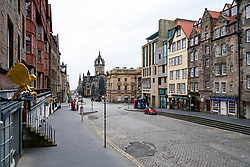 Edinburgh, Scotland, UK. 24 March, 2020.  Deserted streets in the heart of the Old Town tourist district in Edinburgh. All shops and restaurants are closed with very few people venturing outside following the Government imposed lockdown today. Pictured; Empty streets at Lawnmarket on the Royal Mile. Iain Masterton/Alamy Live News