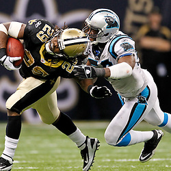 January 1, 2012; New Orleans, LA, USA; New Orleans Saints running back Chris Ivory (29) is grabbed by the hair by Carolina Panthers linebacker James Anderson (50) during the fourth quarter of a game at the Mercedes-Benz Superdome. The Saints defeated the Panthers 45-17. Mandatory Credit: Derick E. Hingle-USA TODAY SPORTS