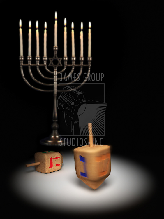 Hanukkah dreidels under a spotlight