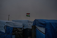 A Kurdish flag is seen on the top a a group of shacks in the Calais refugees camp where about 4500 live. Calais, France. FEDERICO SCOPPA/CAPTA
