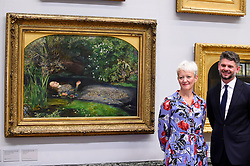 "© Licensed to London News Pictures. 05/09/2018. LONDON, UK.  Maria Balshaw, Director of Tate, and Nick Mitzevich, Director of the National Gallery of Australia, pose with ""Ophelia"", 1851-52, by John Everett Millais, at Tate Britain, to mark the launch of a major new exhibition at the National Gallery of Australia (NGA) in December 2018.  Over forty Pre-Raphaelite works will be loaned by Tate to NGA, which have never been shown in Australia until now, including ""Ophelia"", 1851-52, by John Everett Millais and ""The Lady of Shalott"", 1888, by John William Waterhouse.  Photo credit: Stephen Chung/LNP"