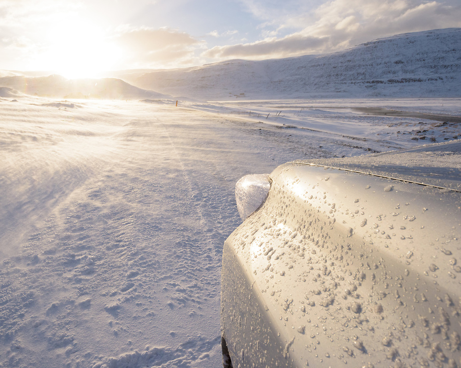 Blowing snow and car, West Fjords,  Iceland