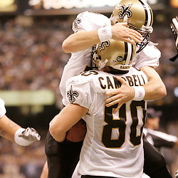 2008 October, 12: New Orleans Saints quarterback Drew Brees (9) leaps into the arms of New Orleans Saints tight end Mark Campbell (80) to celebrate a second half touchdown against the Oakland Raiders at the Louisiana Superdome in New Orleans, LA.