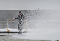"© London News Pictures. 08/02/2014. Aberystwyth, UK. <br /> 43 year old RUSSEL THOMAS, from Worcester, gets caught by a huge wave as gale force winds strike the sea walls at Aberystwyth, Wales at high tide. The winds are forecast to strengthen throughout the day, gusting up to 70 or 80 mph, and with the rising tide, their impact could be potentially damaging again. An amber ""be prepared"" warning  has been issued by the Met Office for wind,. Photo credit: Keith Morris/LNP"