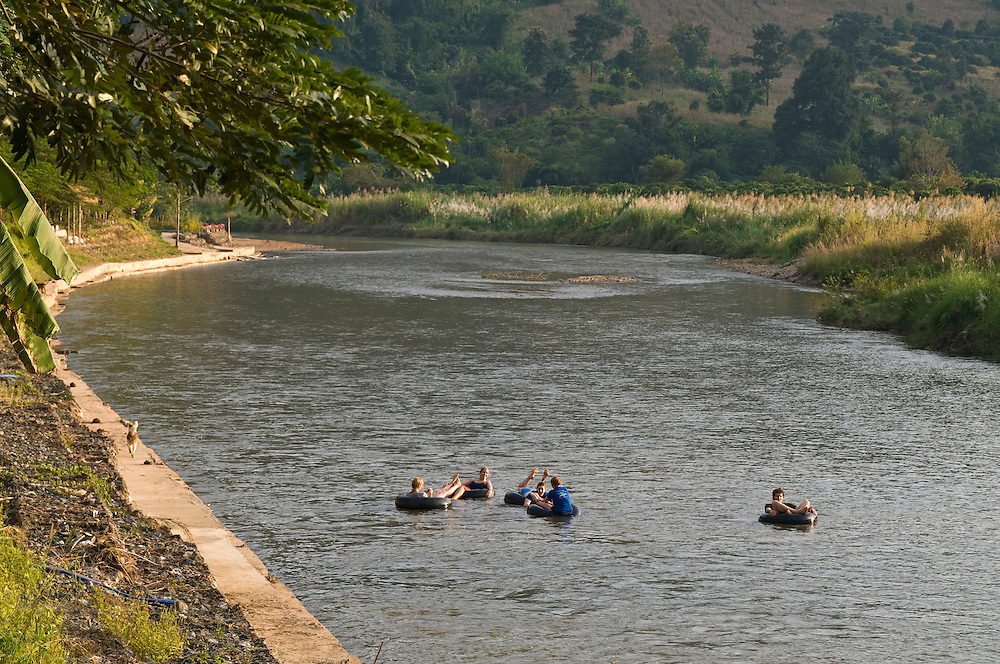 "Tourist and volunteers tubing on the river that passes through the Elephant Nature Park near Chiang Mai, Thailand.  Sangduen ""Lek"" Chailert founded the park as a sanctuary and rescue centre for elephants.  The park currently has 32 elephants sponsored and supported by volunteers from all over the world."