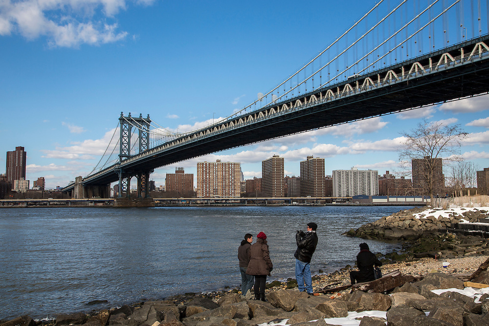 A man takes a photograph from Main Street Park, under the Manhattan Bridge across the East River towards Manhattan from Dumbo, Brooklyn, New York City, United States of America. (photo by Andrew Aitchison / In pictures via Getty Images)