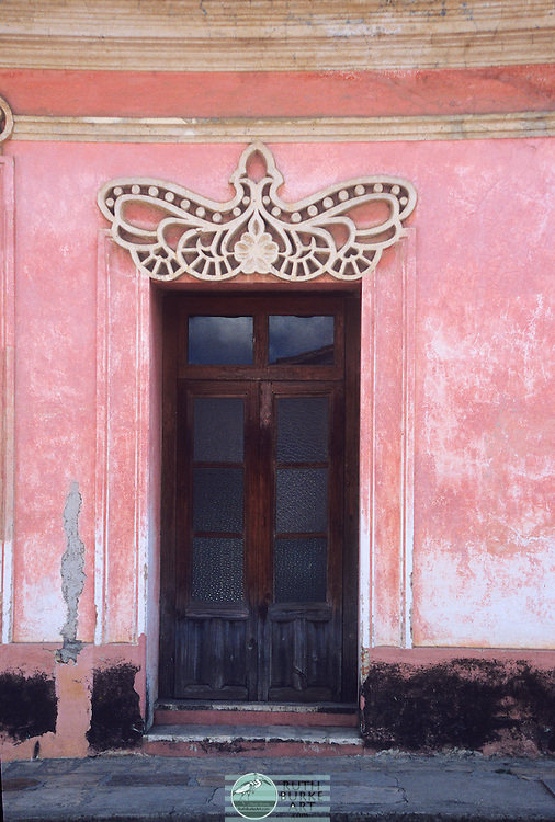 Old world architecture captured in doors and windows from Mexico and Europe.  Walk back in time through worn textures and colors both muted and vibrant.