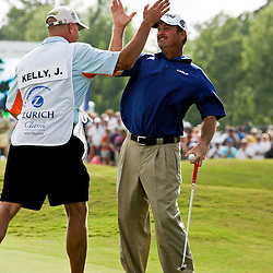 2009 April 26: PGA Tour golf pro Jerry Kelly and his caddie celebrate after Kelly sank a putt on the 18th green to win in the final round of the Zurich Classic of New Orleans PGA Tour golf tournament played at TPC Louisiana in Avondale, Louisiana.