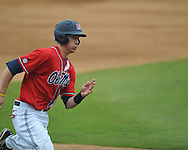 Ole Miss' Alex Yarbrough (2) scores vs. Houston at Oxford-University Stadium in Oxford, Miss. on Sunday, March 11, 2012. Ole Miss won 11-3 to sweep the three-game series.