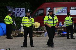 UK ENGLAND WEST SUSSEX BALCOMBE 26JUL13 - Police show a presence as local residents protest at the Cuadrilla hydraulic fracking drill site in Balcombe, West Sussex.<br /> <br /> <br /> Cuadrilla plans to start drilling a 3,000ft (914m) vertical well and a 2,500ft (762m) horizontal bore to the south of the village in search for oil and gas resources.<br /> <br /> <br /> jre/Photo by Jiri Rezac<br /> <br />  / GREENPEACE<br /> <br /> &copy; Jiri Rezac 2013