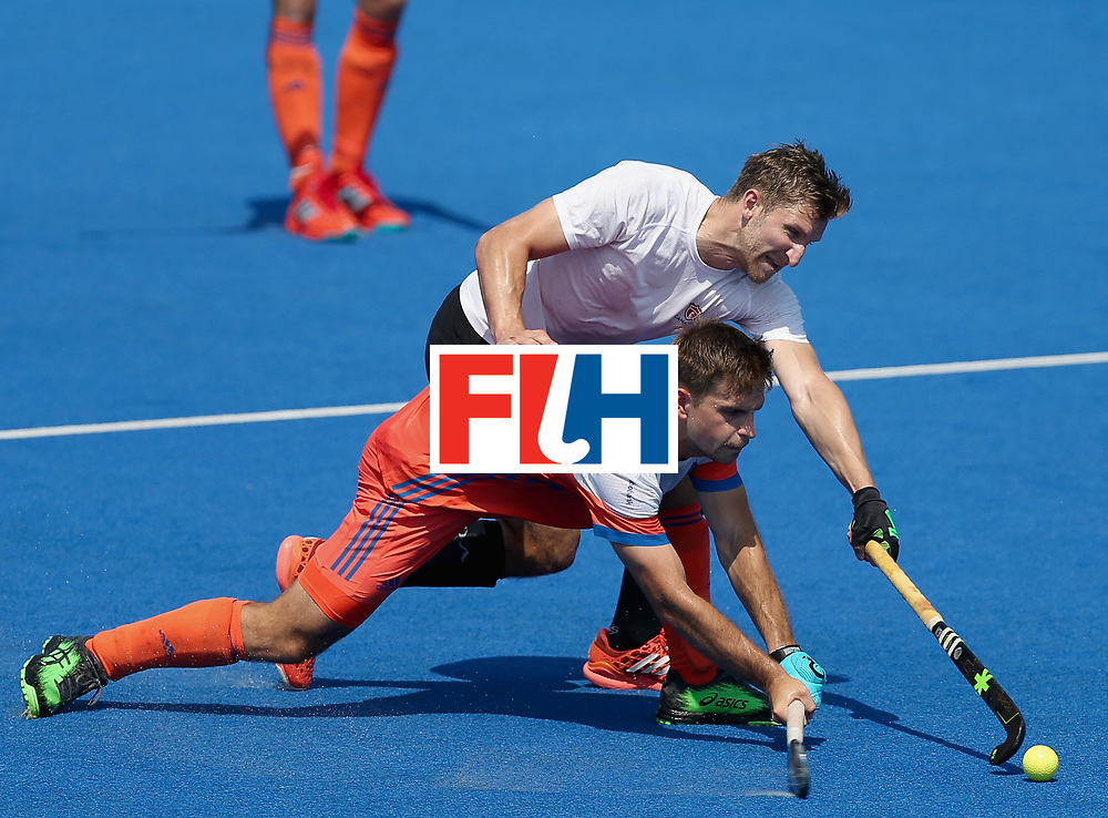 LONDON, ENGLAND - JUNE 19: Tristan Algera of the Netherlands and Mark Pearson of Canada battle for possesion during the Hero Hockey World League Semi-Final match between Netherlands and Canada at Lee Valley Hockey and Tennis Centre on June 19, 2017 in London, England. (Photo by Alex Morton/Getty Images)