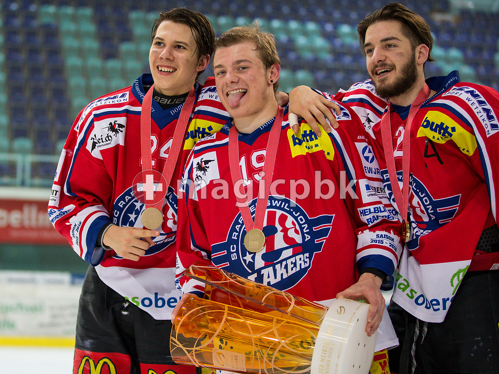 (L-R) Rapperswil-Jona Lakers defenseman Lars Mathis, Gian Andri Gegenschatz and Joel Brotzge pose for a photo with their gold medals and the Swiss Champion trophy after winning the fifth Elite B Playoff Final ice hockey game between Rapperswil-Jona Lakers and ZSC Lions held at the SGKB Arena in Rapperswil, Switzerland, Sunday, Mar. 19, 2017. (Photo by Patrick B. Kraemer / MAGICPBK)
