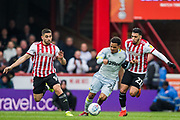 Duane Holmes (Derby County) & Neal Maupay (Brentford) & Said Benrahma (Brentford) during the EFL Sky Bet Championship match between Brentford and Derby County at Griffin Park, London, England on 6 April 2019.