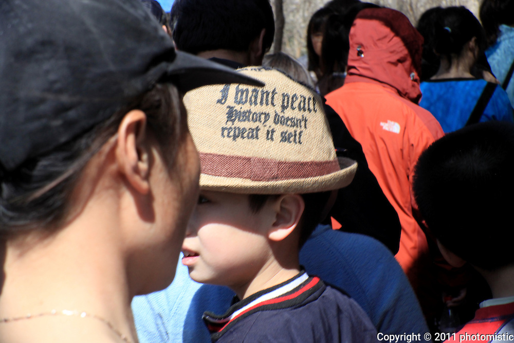 cool kid on Baodu Mountain with <br /> a &quot;I want peace. history doesn't repeat itself&quot; hat<br /> Shijiazhuang, Hebei, China